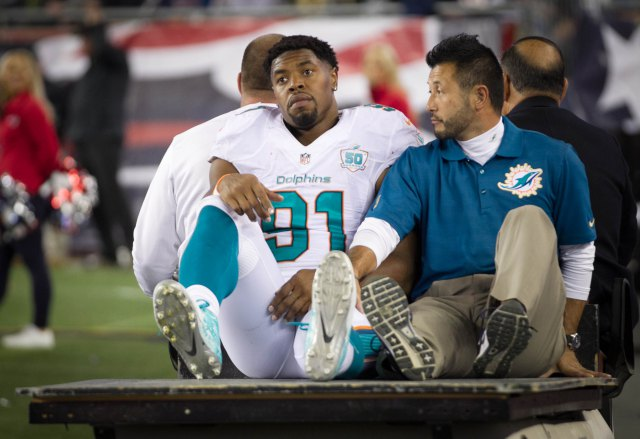 Miami Dolphins defensive end Cameron Wake (91) injured his achillies in the third quarter at Gillette Stadium in Foxborough, Massachusetts on October 29, 2015.  (Allen Eyestone / The Palm Beach Post)