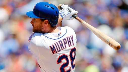 NEW YORK, NY - JUNE 15: Daniel Murphy #28 of the New York Mets follows through on a second inning run scoring sacrifice fly against the San Diego Padres at Citi Field on June 15, 2014 in the Flushing neighborhood of the Queens borough of New York City. (Photo by Jim McIsaac/Getty Images)