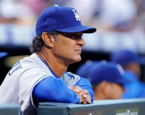 Los Angeles Dodgers manager Don Mattingly watches as his team plays the Colorado Rockies in the first inning of a baseball game in Denver on Saturday, June 2, 2012. (AP Photo/David Zalubowski)